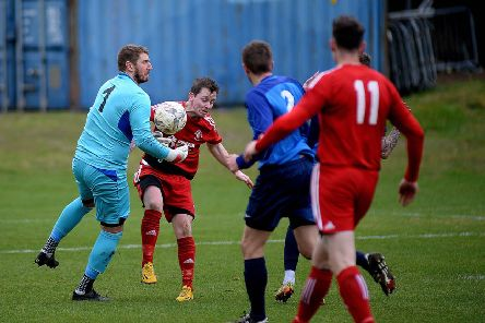 Hawick Royal Albert goalie Craig Saunders has the ball under control against Easthouses Lily (picture: Alwyn Johnston)