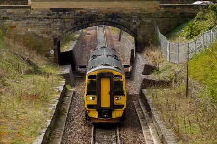 A train on the single track section of the Borders Railway, at Eskbank.