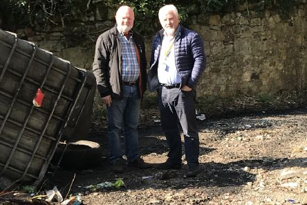 Cllr Cassidy and Colin Beattie MSP as the site of spillage, at the Newbattle Storm Water Works