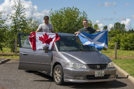 Monday 10th of June 2019: Midlothian Advertiser. Ross Murray from Dalkeith (green top) and his friend James from Canada have just travelled 23,000 km from Japan  in a �700 Honda