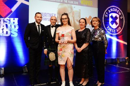 Gorebridge teen, Courtney Simpson was recognised at the Scottish First Aid Awards for outstanding contribution to first aid. Pictured: David Farrell, Yvonne Goodfellow (Scotmid), Leigh and Richard Allan and Courtney Simpson.