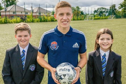 Rangers star Greg Docherty launches his new Football Academy at Douglas Academy, with the help of pupils Reiss Weir and Marnie Sayer