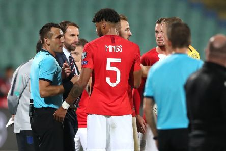 England manager Gareth Southgate and defender Tyrone Mings in discussion with referee Ivan Bebek amid racist chanting by a section of Bulgaria supporters. Picture: PA Wire