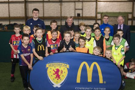 McDonald's Fun Football ambassador Kenny Dalglish pays a surprise visit to children at  Allander Leisure Centre in Bearsden