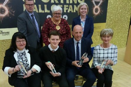 McAllister (front row, 2nd right) with family members of other new inductees to Hall of Fame (Pic by Craig Goldthorp)