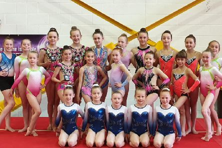 The group of Dynamic Gymnastic Academy girls who excelled at competitions throughout May