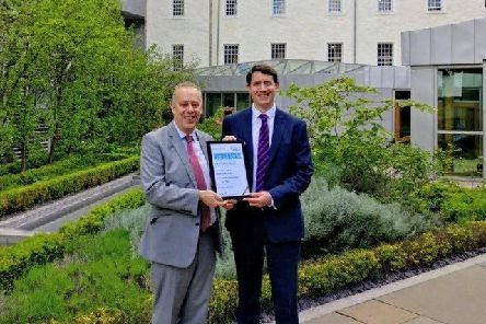 Central Scotland list MSP Mark Griffin receiving his award from Simon Hodgson, director of Carers Scotland