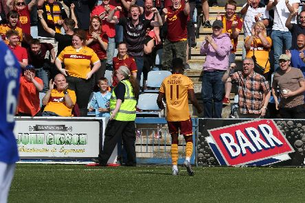 Sherwin Seedorf celebrates with fans after putting Motherwell 2-0 up (Pic by Ian McFadyen)