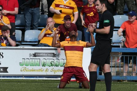 Sherwin Seedorf celebrates his fine goal at Palmerston in front of Motherwell supporters (Pic by Ian McFadyen)