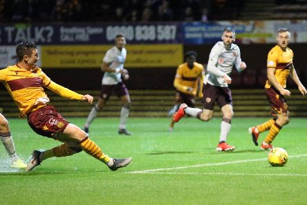 Christopher Long shoots home Motherwell's goal against Hearts (Pic by Ian McFadyen)