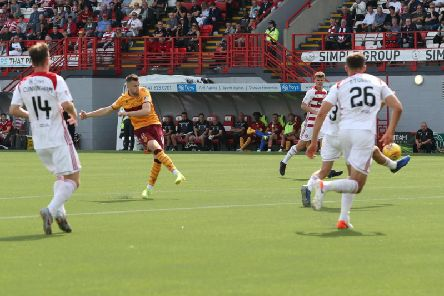 Liam Polworth launches a first half effort on goal for Motherwell at Hamilton (Pic by Ian McFadyen)