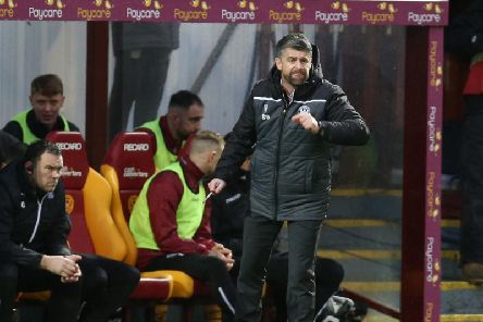 Well gaffer Stephen Robinson encourages his troops against Hearts (Pic by Ian McFadyen)