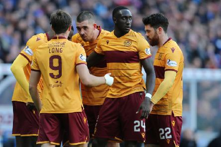 Motherwell players celebrate taking the lead against Rangers at Ibrox on October 27 (Pic by Ian McFadyen)