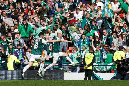 Delirious Hibs fans celebrate after David Gray scores the winning goal in the Scottish Cup final. Picture: Robert Perry