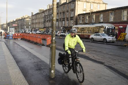 A new cycle lane on Leith Walk on the pavement which has a lamp post in the middle of it. Picture; Greg Macvean
