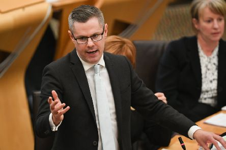 Finance Secretary Derek Mackay addresses the Scottish Parliament during the Draft Scottish Budget. Picture: Jeff J Mitchell/Getty Images)