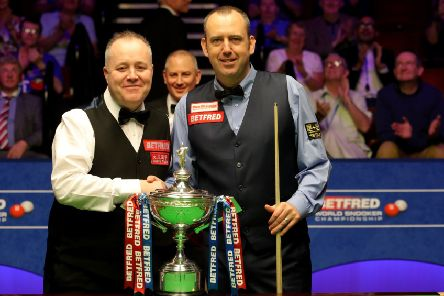 John Higgins, left, and Mark Williams pose with the trophy before the start of the World Championship final at The Crucible. Picture: PA
