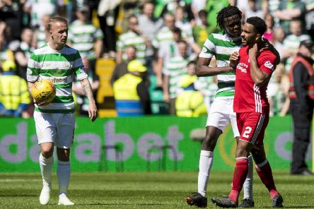 Leigh Griffiths, left, and Dedryck Boyata were both guilty of throwing the ball at Aberdeen's Shay Logan. Picture: SNS