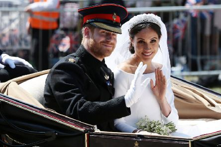 Prince Harry, Duke of Sussex and Meghan, Duchess of Sussex wave from the Ascot Landau Carriage during their carriage procession on Castle Hill. Picture: Aaron Chown - WPA Pool/Getty Images