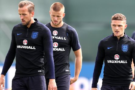 Harry Kane, Eric Dier and Kieran Trippier take a break during a training session in St Petersburg. Picture: Getty Images