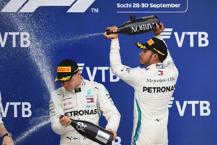 Lewis Hamilton sprays team-mate Valtteri Bottas following his controversial victory in Russia. Picture: Getty