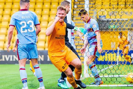 Livingston's Alan Lithgow celebrates after making it 3-0 over Dundee. Picture: SNS Group