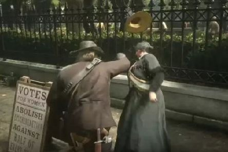 The player and suffragette engage in a short conversation before Shirrako prompts Arthur Morgan to attack her (Image: YouTube/Shirrako/Rockstar Games)