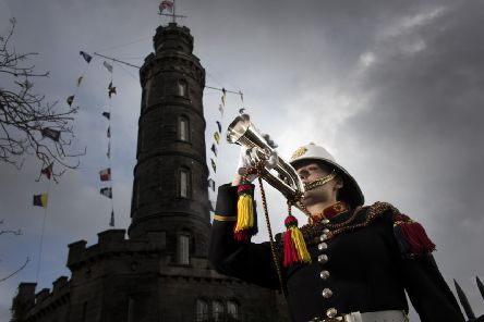 Bugler Samantha Lowe, of the Royal Marine Band Scotland, plays the Last Post at the Nelson Monument on Edinburgh's Calton Hill to mark Trafalgar Day (Picture: Andrew O'Brien)
