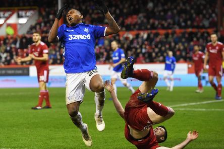 Alfredo Morelos and Scott McKenna were both sent off after tangling at Pittodrie. Pic: SNS/Craig Williamson