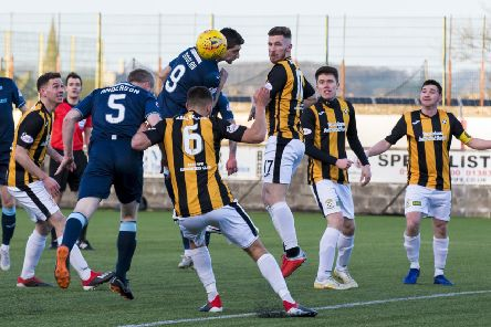 Partick Thistle's Steven Anderson opens the scoring with a header. Pic: SNS/Bruce White