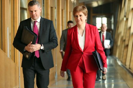 First Minister Nicola Sturgeon with Finance Minister Derek Mackay. Picture: Jane Barlow/PA Wire