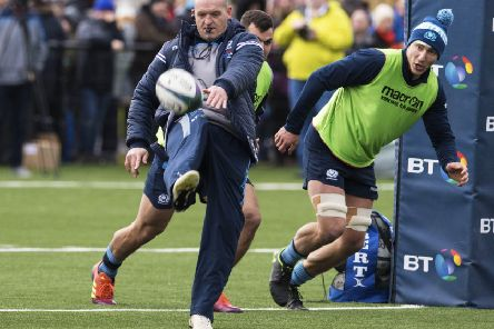 Scotland coach Gregor Townsend kicks ahead for flanker Jamie Ritchie to chase at a training session in Clydebank