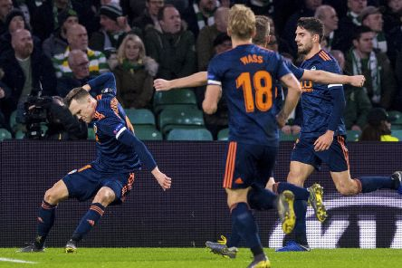 Denis Cheryshev celebrates the goal which put Valencia ahead at Celtic Park. Picture: SNS/Alan Harvey