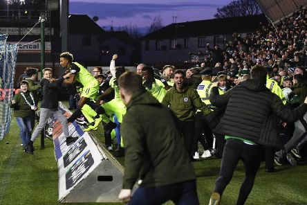 Celtic fans stream onto the pitch following Scott Brown's late winner. Picture: SNS Group