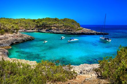 The secluded bays and quiet fishing villages are a world away from the party hotspots of Majorca