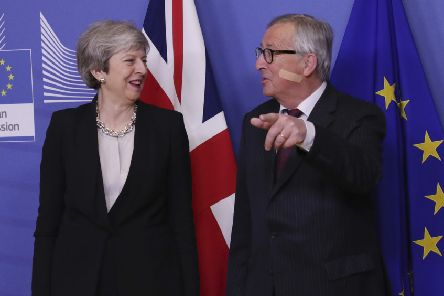 British Prime Minister Theresa May, left, is greeted by European Commission President Jean-Claude Juncker. (AP Photo/Francisco Seco)