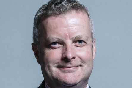 Christopher Davies, the MP for Brecon and Radnor, was charged today by police
