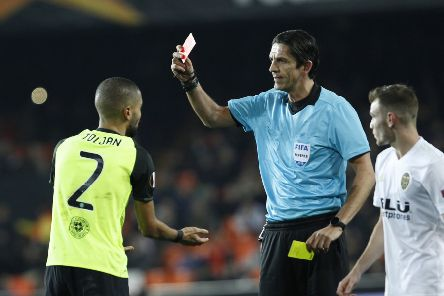 Jeremy Toljan receives his second yellow card during the first half. Picture: AP