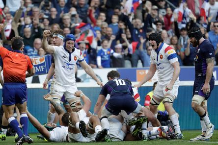 France's players react after back row Greg Alldritt scored a try. Pic: Thomas Samson/AFP/Getty Images