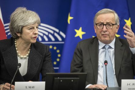 Theresa May and European Commission President Jean-Claude Juncker (Picture: Jean-Francois Badias/AP)
