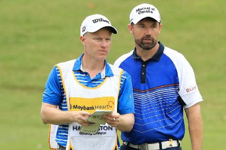 Padraig Harrington talks tactics with caddie Ronan Flood during the first round of the Maybank Championship in Malaysia. Picture: Getty Images