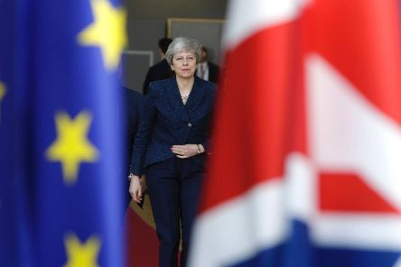 Theresa May arrives in Brussels on the first day of an EU summit focused on Brexit (Picture: Aris Oikonomou/AFP/Getty)
