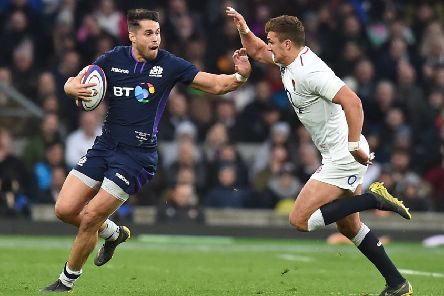 Scotland winger Sean Maitland hands off England's Henry Slade. Picture: Glyn Kirk/AFP/Getty Images