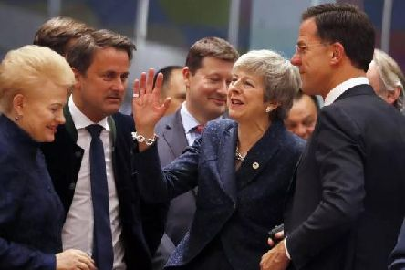 Prime Minister Theresa May greets fellow EU leaders in Brussels