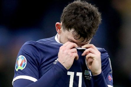 Oliver Burke hides his despair as Scotland lose to Kazakhstan in Euro 2020 qualifying. Picture: PA