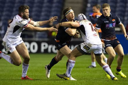 Edinburgh's Hamish Watson (centre) is stopped in his tracks against Ulster. Picture: Bill Murray/SNS