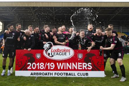 The Arbroath players celebrate promotion to the Ladbrokes Championship. Pic: SNS/Ross MacDonald
