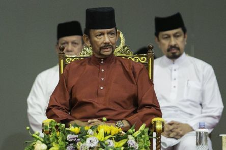 Brunei's Sultan Hassanal Bolkiah, centre, attends an event in Bandar Seri Begawan. Picture: AFP/Getty Images