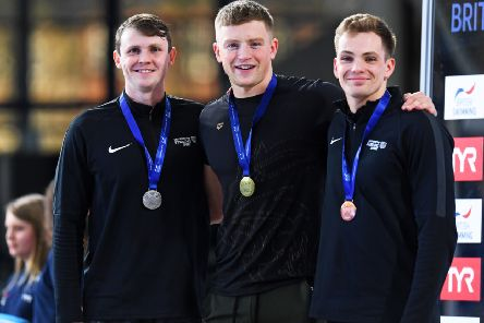 Ross Murdoch, left, Adam Peaty and Craig Benson show off their medals after the men's 50m breaststroke. Pic: Craig Williamson/SNS