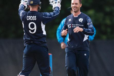 Con de Lange (right) celebrates with Matthew Cross after taking a wicket during his 5-60 haul against Zimbabwe in June 2017